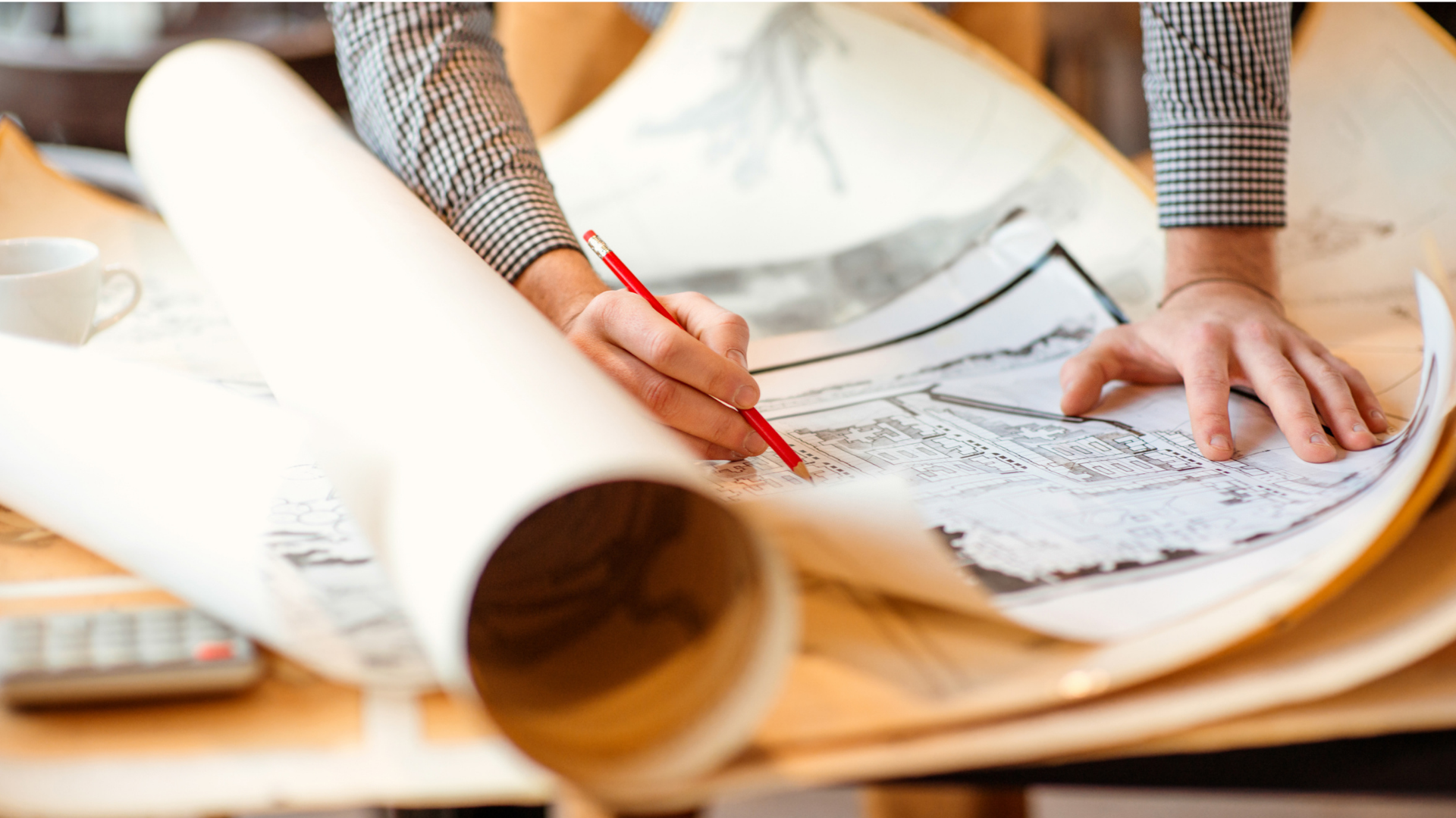 Best Online Master's Architecture - featured image of architect working on a project blueprint